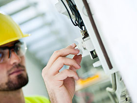 Electrical worker changing a fuse